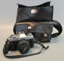Minolta X-300 35mm SLR camera outfit, the camera with standard 50mm lens, together with additional