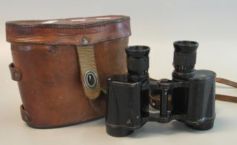 Pair of probably British military binoculars or field glasses in original leather case, bearing