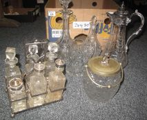Box containing two cut glass decanters and a beautifully etched glass and white metal carafe, two