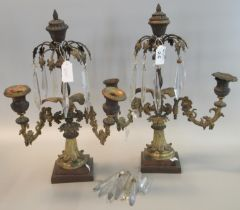 Pair of early 19th Century Empire design two branch gilt metal table candelabra with glass