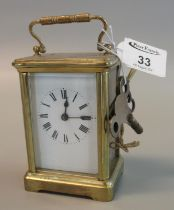 Small French brass carriage clock with full depth Roman enamel dial, with keys, case 114cm high