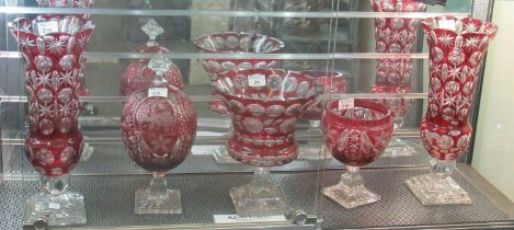 A collection of ruby flash cut glass items to include; pair of vases, pedestal centre bowl and two