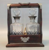 Reproduction mahogany two section glass tantalus with key. (B.P. 21% + VAT)