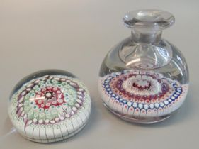 Two multi-coloured cane art glass paperweights, both with pontil marks. (2) (B.P. 21% + VAT)