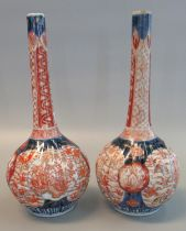 Pair of Japanese porcelain Imari design rosewater type baluster shaped fluted vases overall with