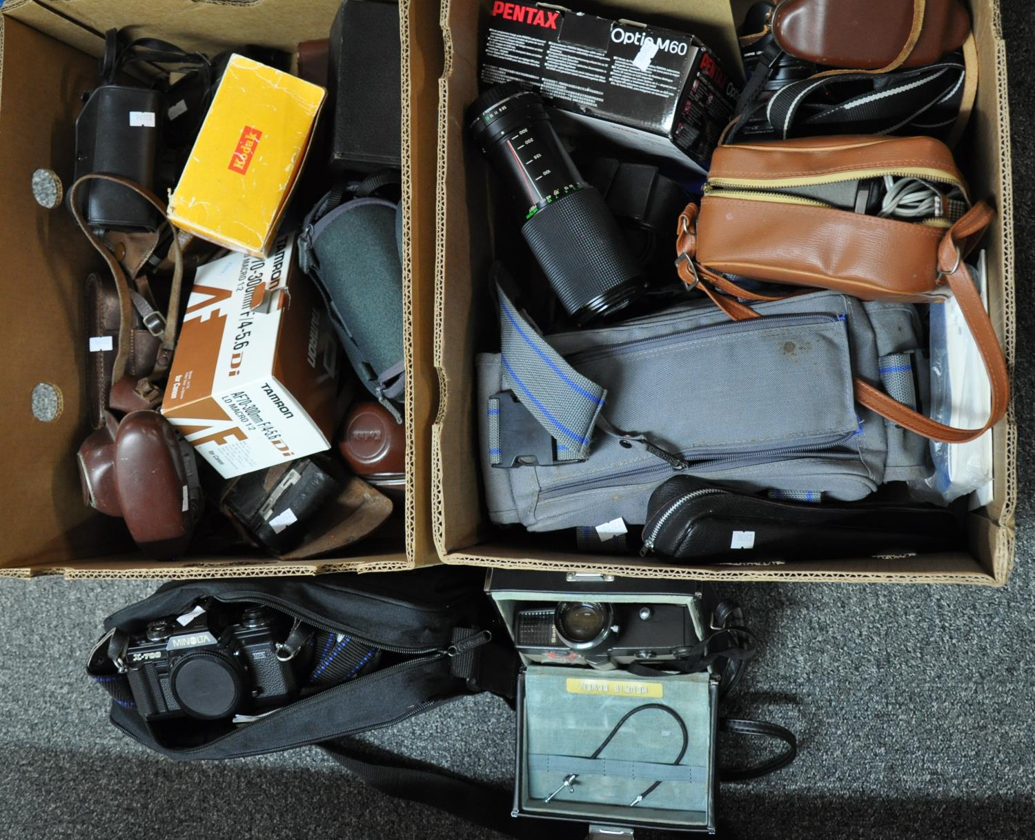 Two boxes of various camera equipment to include: an Olympus 8.0 digital camera with wide angle