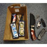 Wooden herb garden two-handled trug comprising various pocket knives. (B.P. 21% + VAT)