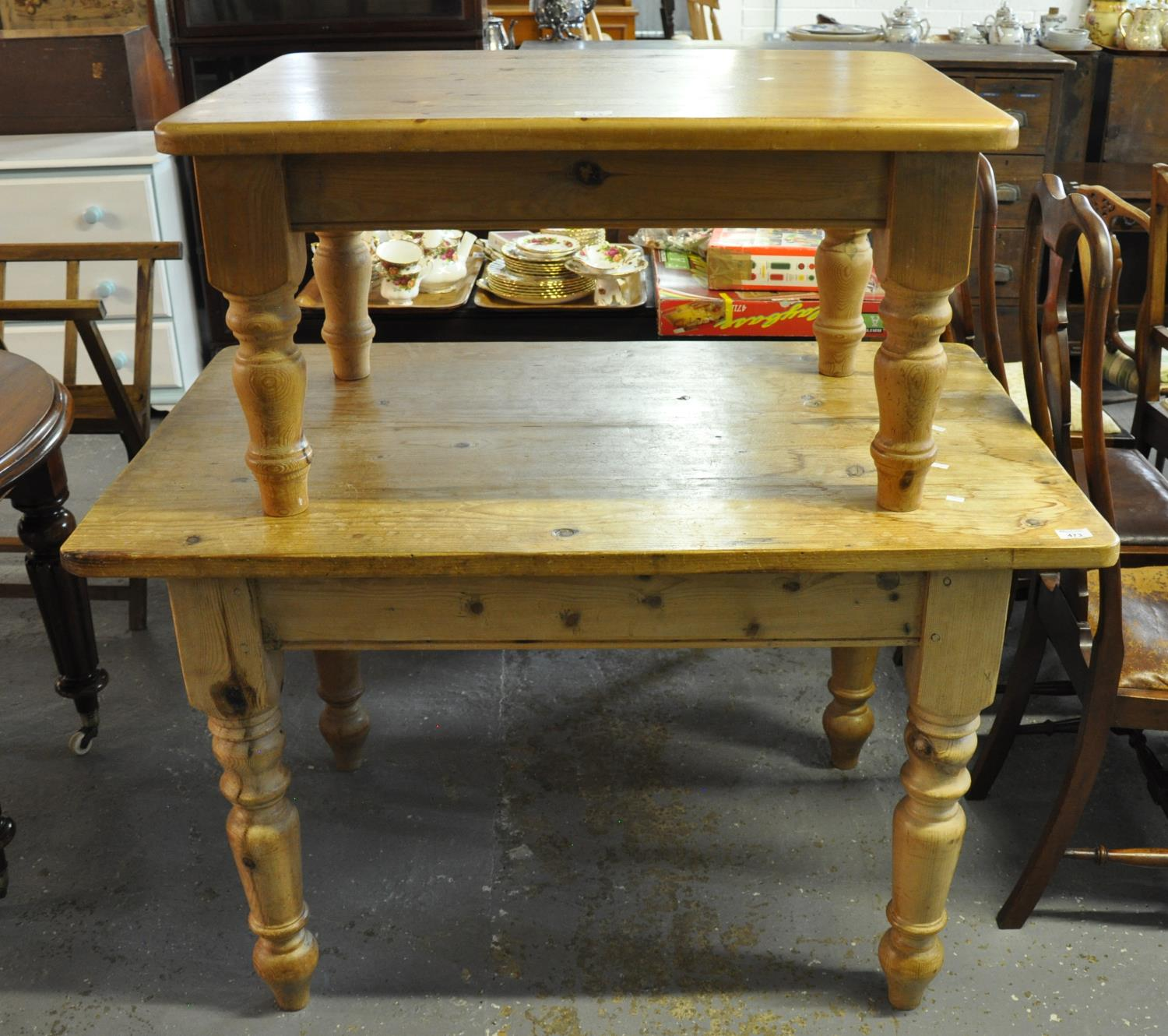 Pine farmhouse kitchen table on baluster turned legs, together with a smaller pine coffee table on