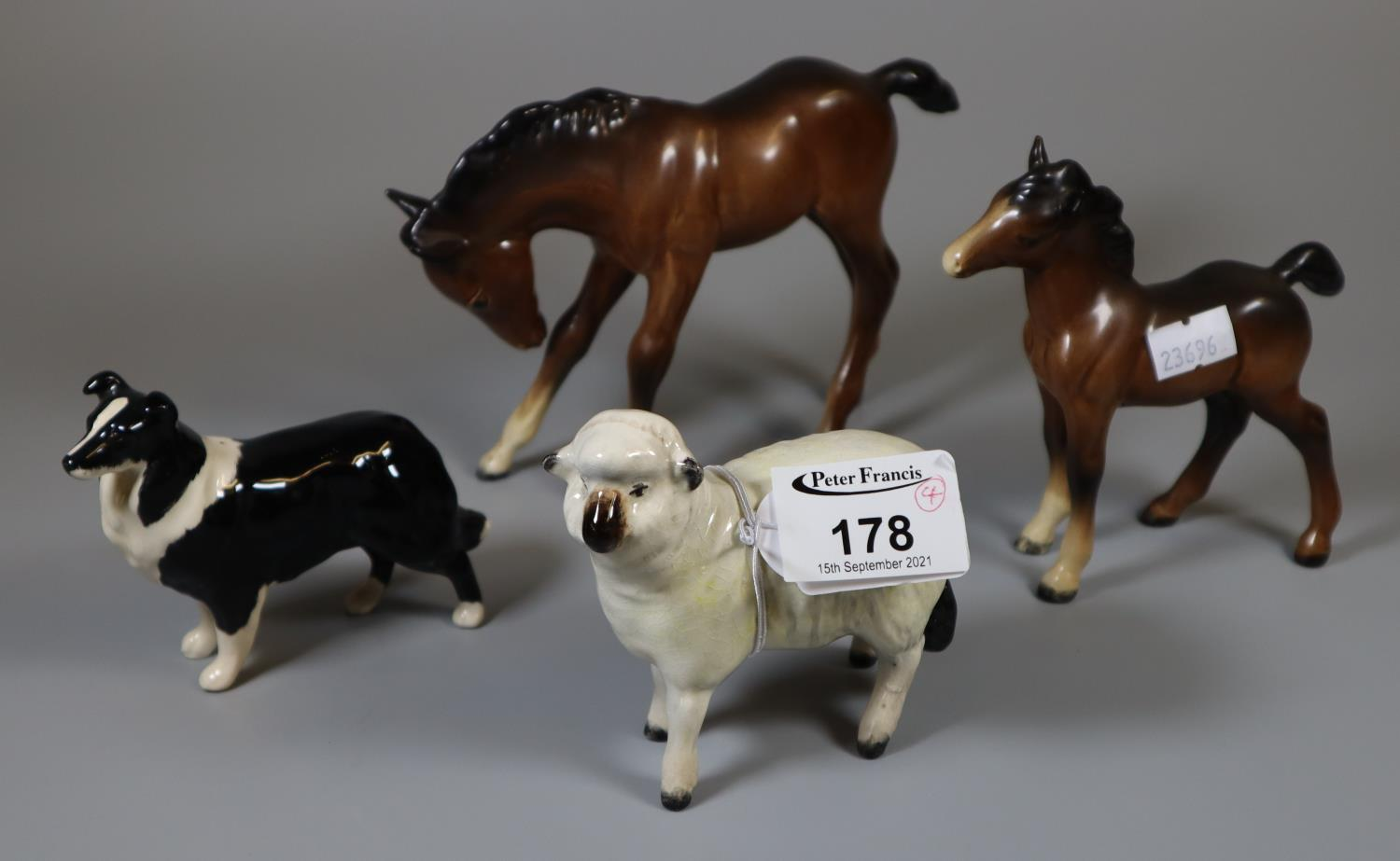 Four Beswick animal figurines to include; horse and foal, sheepdog and goat. (4) (B.P. 21% + VAT)