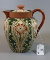 Moorcroft Macintyre Florian single handled lidded teapot of baluster form, tube lined decoration