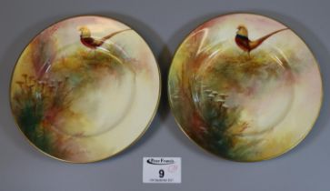 Pair of Royal Worcester porcelain side plates hand painted with pheasants amongst foliage, signed
