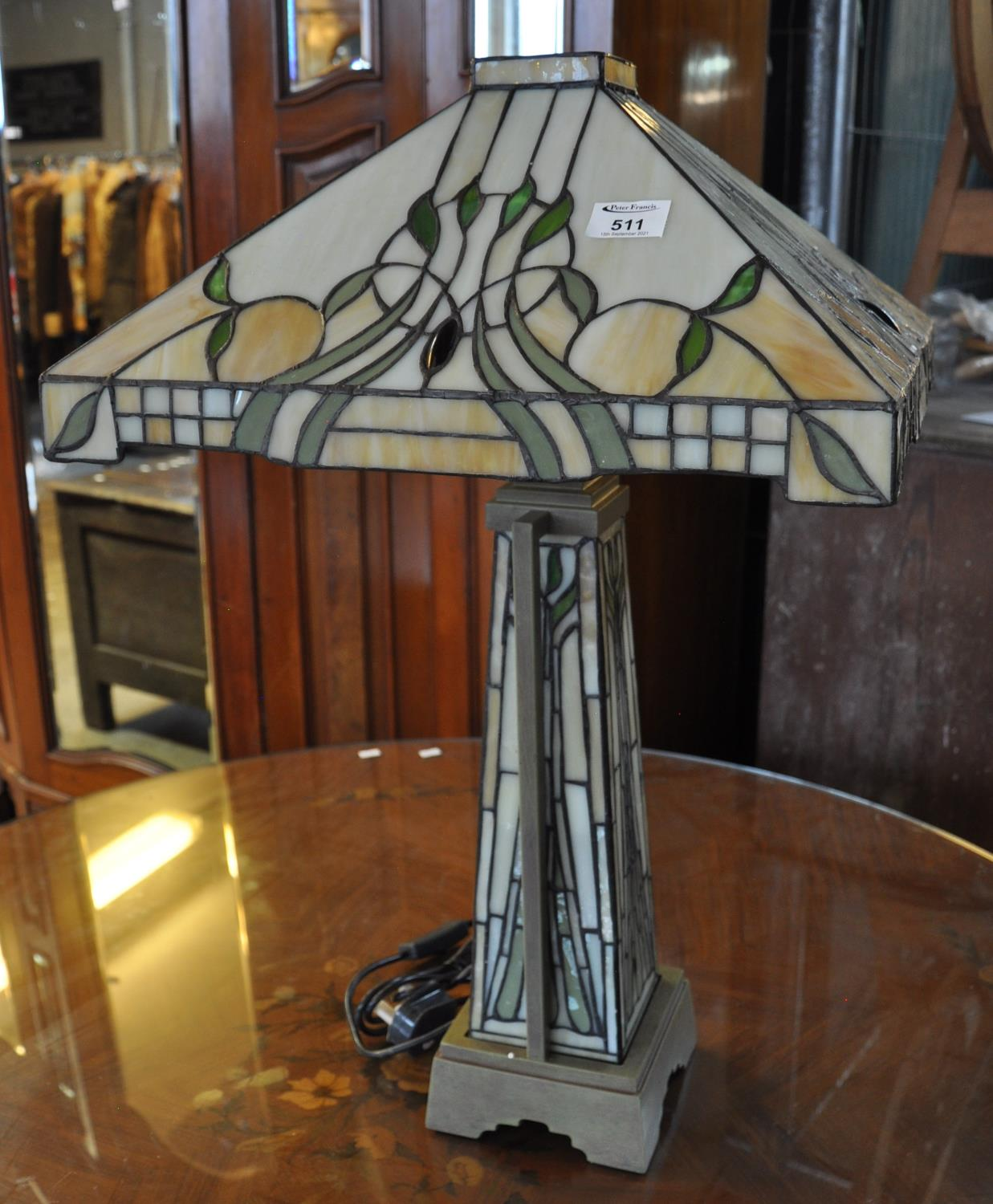 Art Nouveau style Tiffany design table lamp having fruits, berries and foliage on a tapering