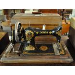 Vintage Jones sewing machine with fitted hood. (B.P. 21% + VAT)