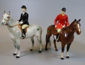 Beswick huntsman/woman on dapple grey horse, together with another Beswick horse with huntsman in