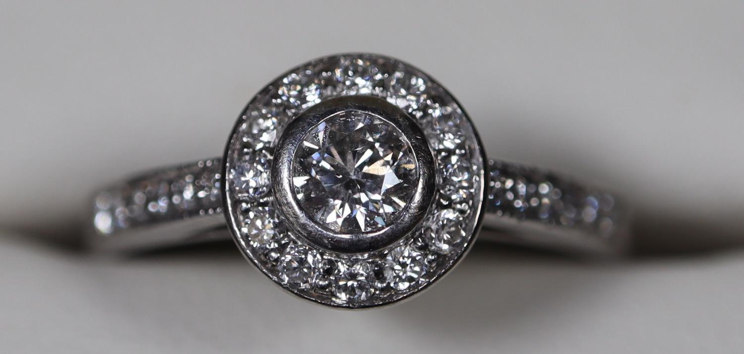 18ct white gold and diamond halo ring. Size L. Approx size L Approx weight 3 grams. (B.P. 21% + VAT) - Image 2 of 3