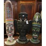 Three carved wooden totem type polychrome decorated masks. Possibly modern south seas. 69 cm