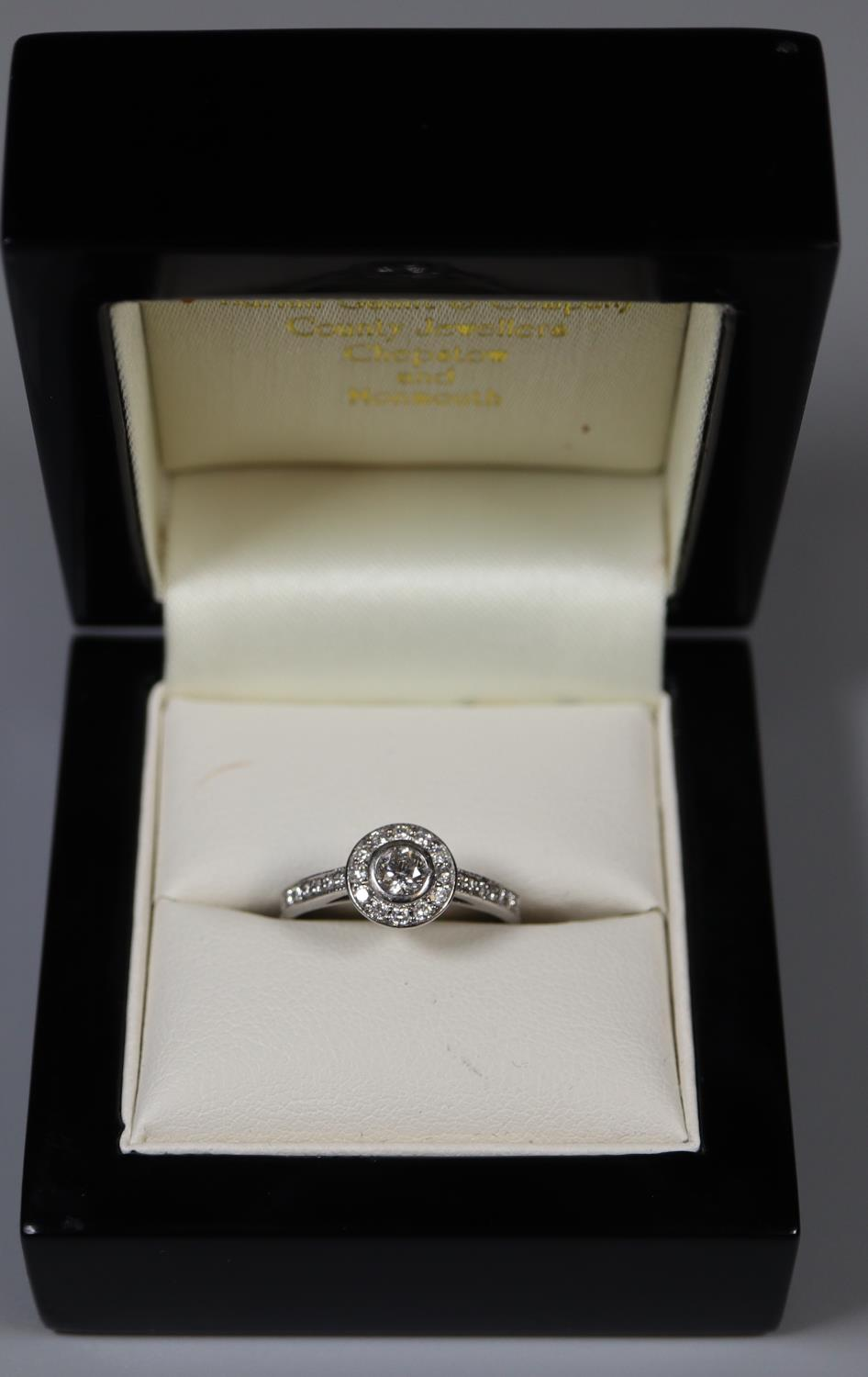 18ct white gold and diamond halo ring. Size L. Approx size L Approx weight 3 grams. (B.P. 21% + VAT)