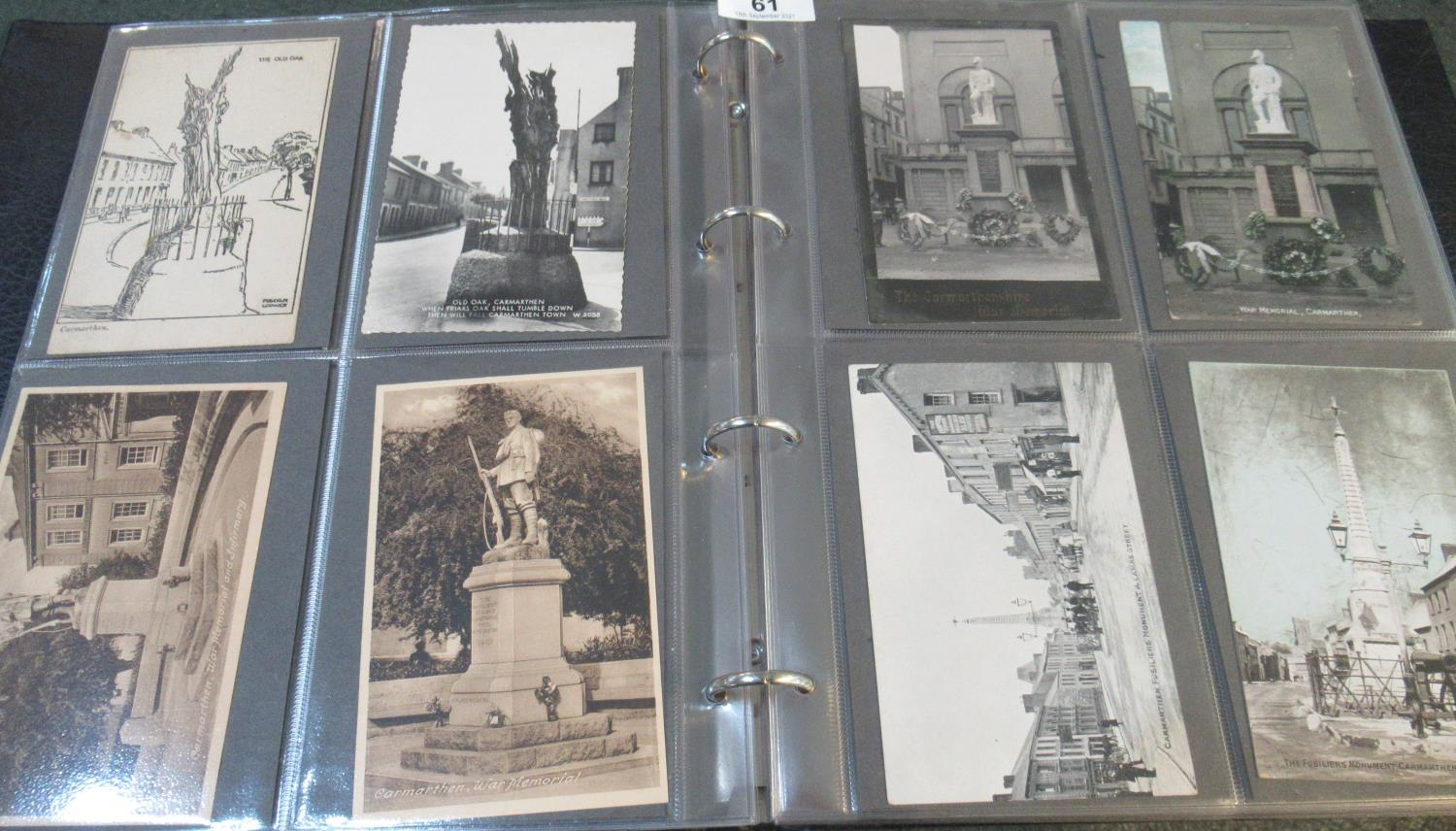 Postcards of Carmarthenshire in black album; Notts square, Guildhall square, The Old Oak, War