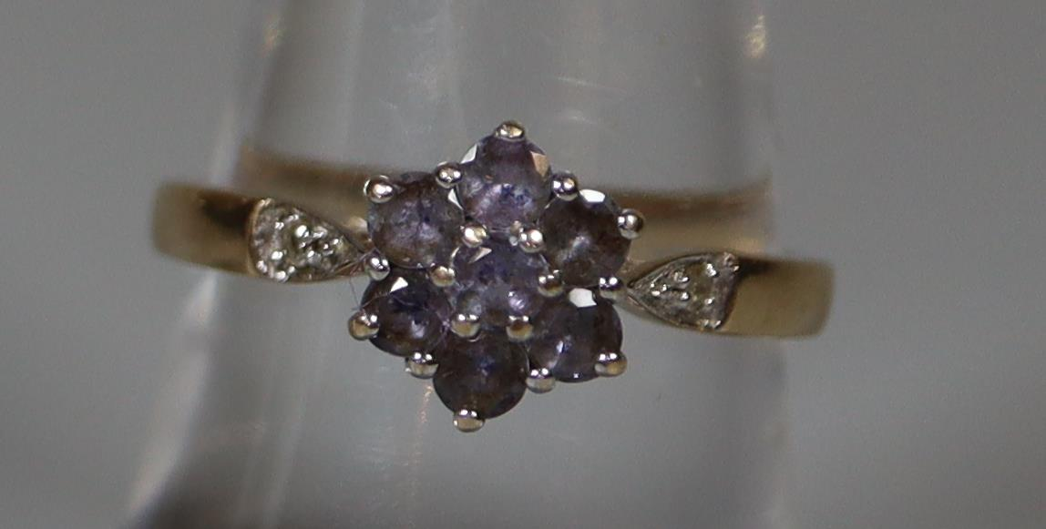 9ct gold cluster ring of pale blue stones with diamond shoulders. Ring size O. Approx weight 2.5