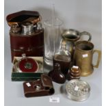 Plastic tray of oddments to include tankards, leather and glass hipflask, hipflask in the form of