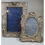 Two silver art nouveau picture frames with organic repousse decoration. (2) (B.P. 21% + VAT)