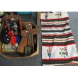 Box of assorted items to include; a woollen wall hanging in Peruvian style, two Gollywogs, a tin