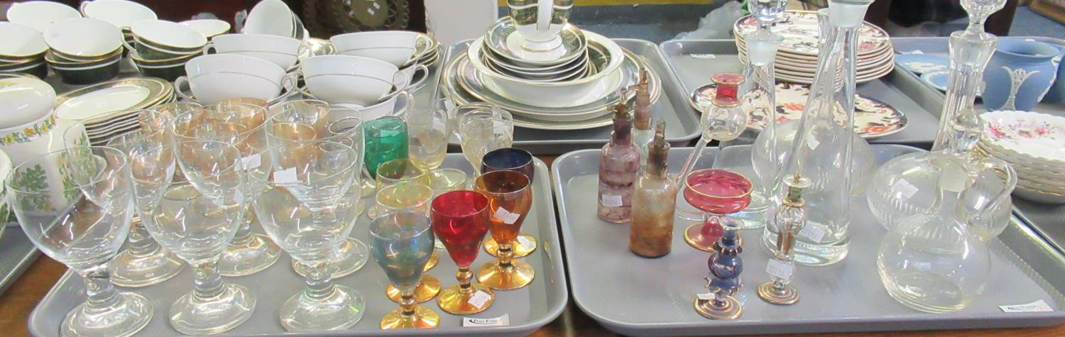 Two trays of assorted glassware to include; cut and plain glass decanters with stoppers, scent