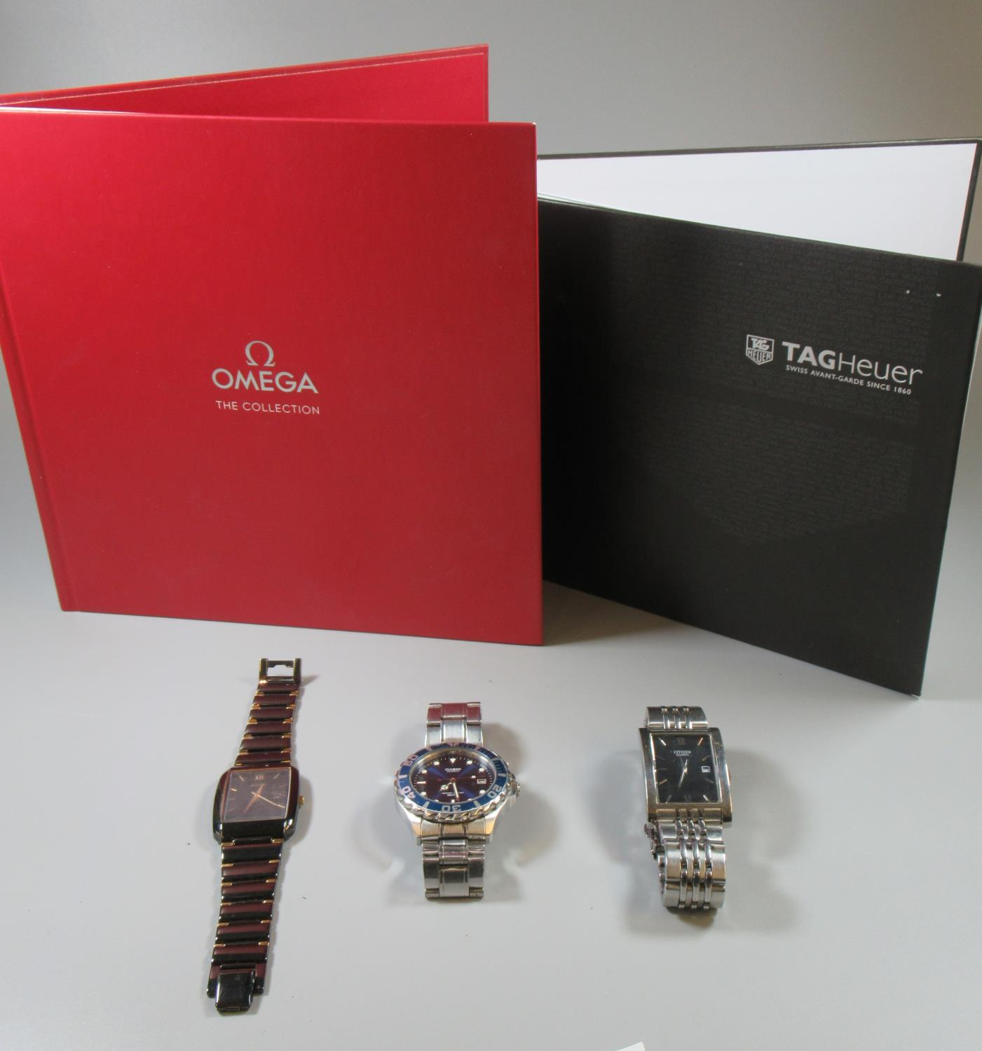 Omega The Collection book, together with a similar Tag Heuer book,together with a shoe box of