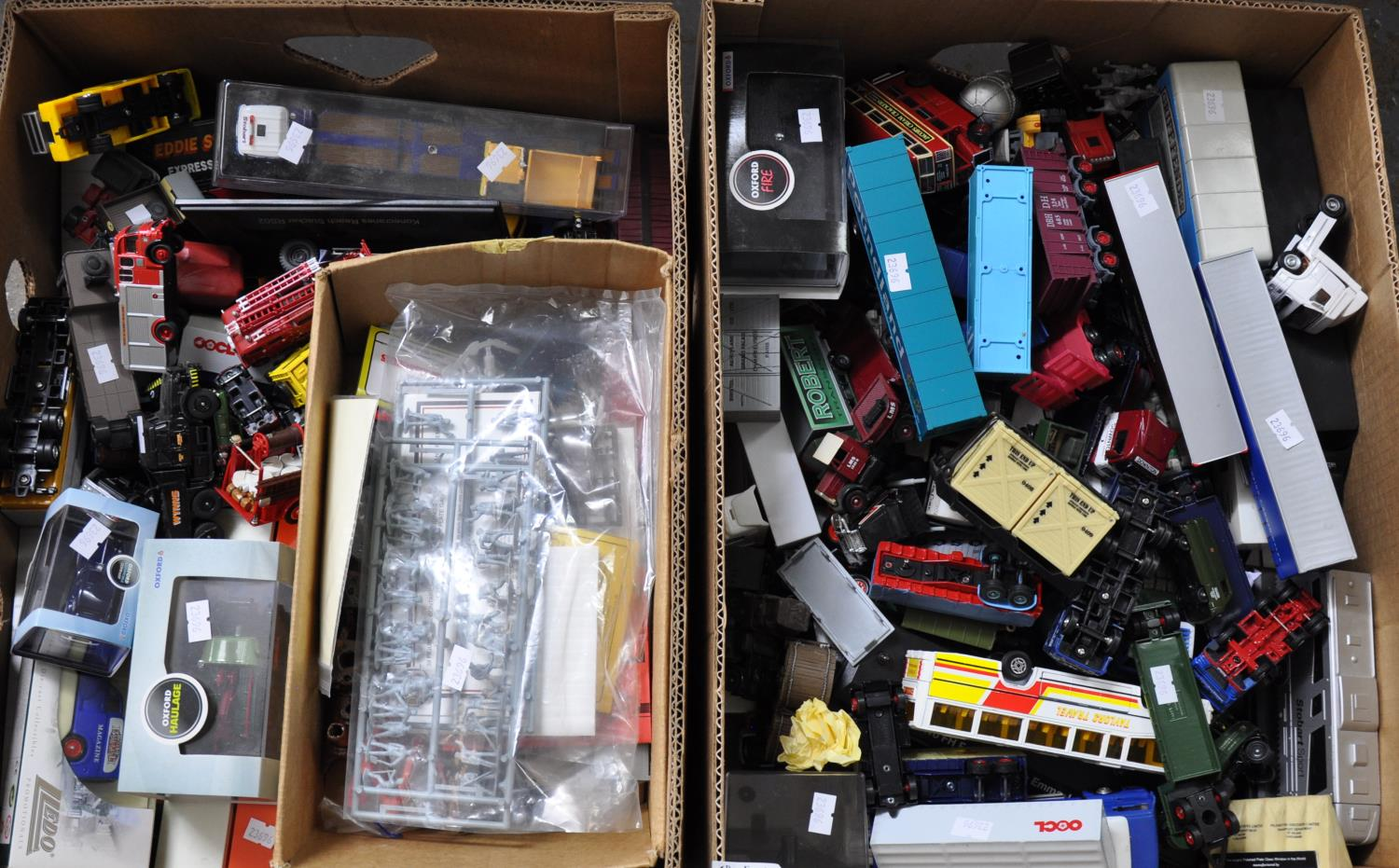 Two boxes of boxed and play worn diecast model vehicles to include; Oxford haulage, Oxford fire,