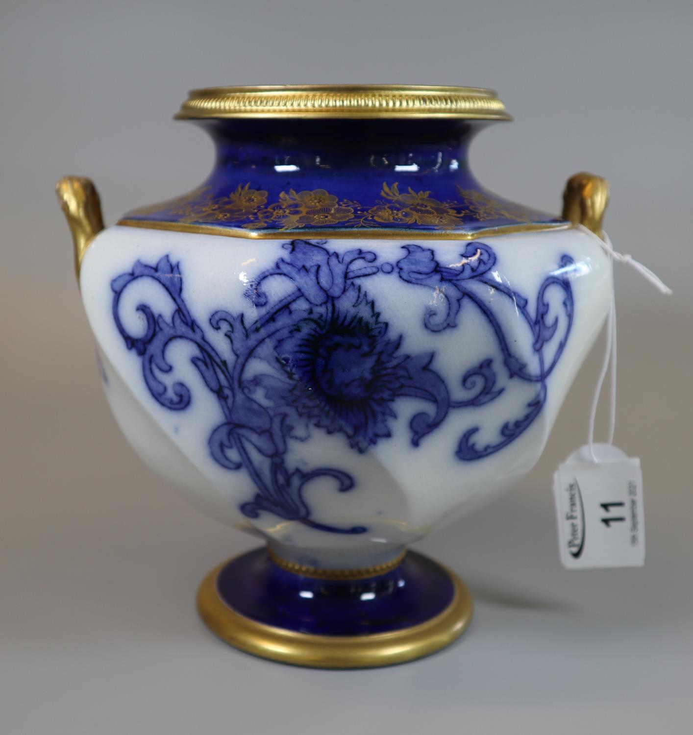 Moorcroft Macintyre blue and white floral and foliate two handled vase with gilded mounts, handles