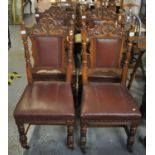 A pair of four late Victorian oak dining chairs having carved stylised dragon decoration on fluted