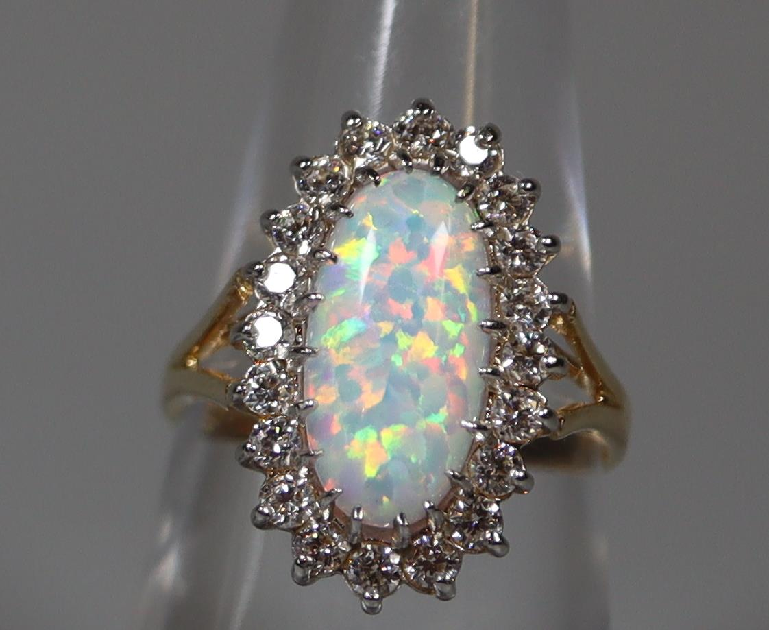 9ct gold synthetic opal and white stone ring. Ring size L. Weight approx 3.2 grams. (B.P. 21% + VAT)