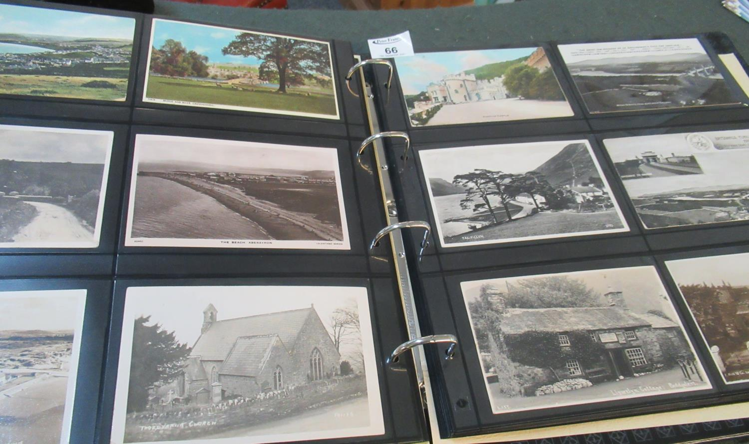 Postcards collection in large black boxed album; topographical with Welsh interest, humorous,