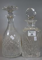 Two cut glass decanters of square section and hob nail form with faceted and mushroom stopper. (