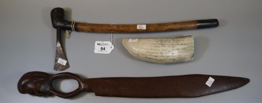 African iron 'Lozi' axe, together with a figural wooden knife and a 'Scrimshaw' resin whale's