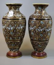 A pair of late 19th Century Doulton Lambeth stoneware vases of baluster form with painted stylised
