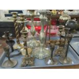 Tray of assorted brass candlesticks to include; various pair of decorative and plain, one single