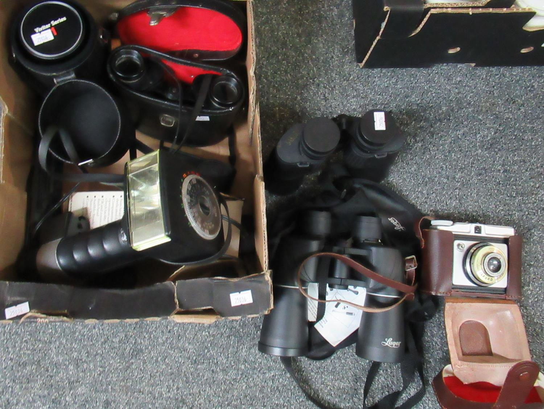 Box of assorted camera equipment and binoculars to include; Sakura 10x -70 x 70 zoom binoculars,