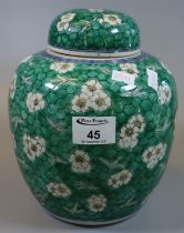 Chinese porcelain baluster-shaped ginger jar and cover, 'Cracked Ice' pattern over a green enamelled