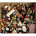 Box containing a large collection of alcoholic miniature spirits to include; rum, vodka, whisky,