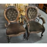 Pair of Victorian walnut ladies and gentleman's button-back upholstered fireside chairs. (2) (B.P.