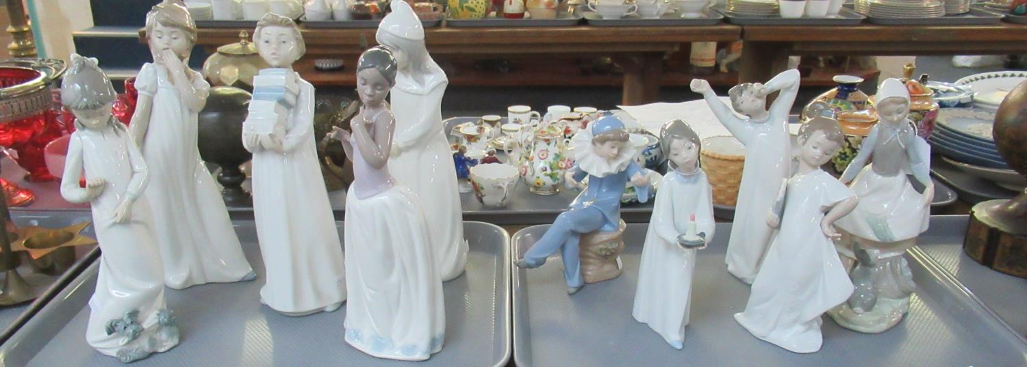 Two trays of assorted Spanish porcelain figurines to include; Nao and Lladro; three Lladro to