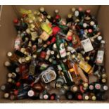 Box containing a large collection of alcoholic miniature spirits to include; liqueurs, whisky,
