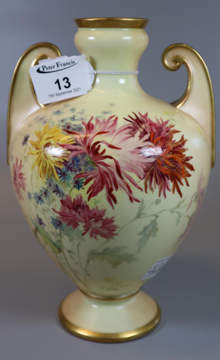 Royal Worcester blush ivory two handled vase of baluster form decorated with spring flowers,