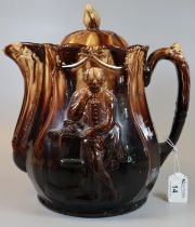 Large brown ground treacle glazed pottery lidded water jug or teapot with moulded decoration of
