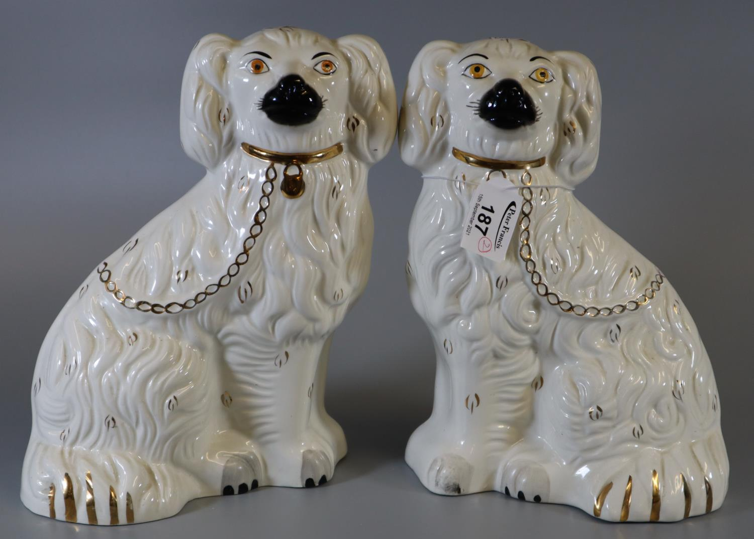 Pair of Beswick pottery fireside dogs with painted features. (B.P. 21% + VAT)