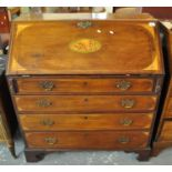 Edwardian mahogany inlaid slope front bureau having shell and fan inlay above four long drawers on a