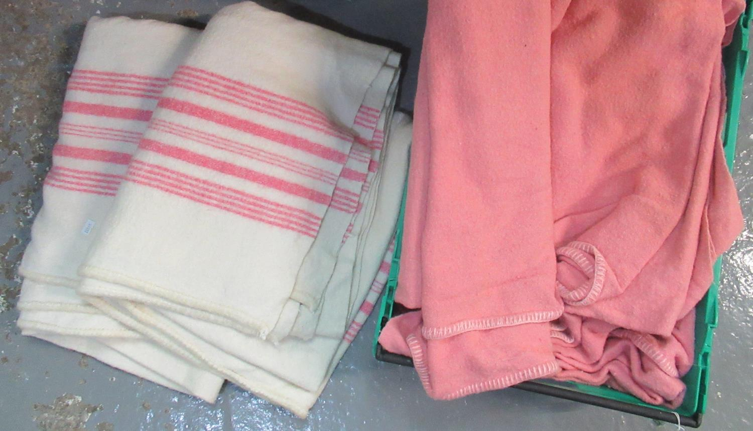 Box containing three plain vintage woollen blankets, and two cream with pink stripes with 'Popular