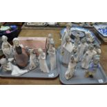 Two trays of Lladro and Nao figurines: girls and children, one in the original box. (17) (B.P. 21% +