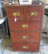 Stained narrow straight front chest of two short and three long drawers and brass recessed